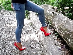 Extreme high-heeled slippers and jeans, my stunning legs,walk in the woods